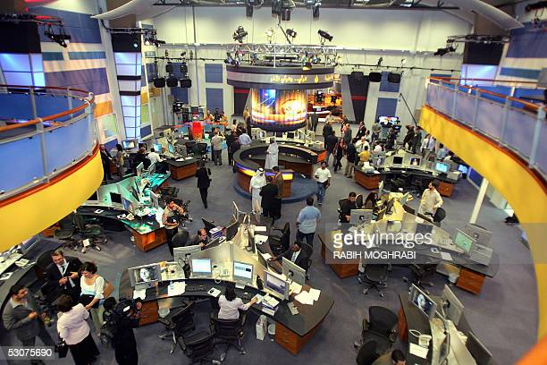 Arab and Qatari staff work at alJazeera's new stateoftheart newsroom late 15 June 2005 The Dohabased satellite news channel which has moved into a...