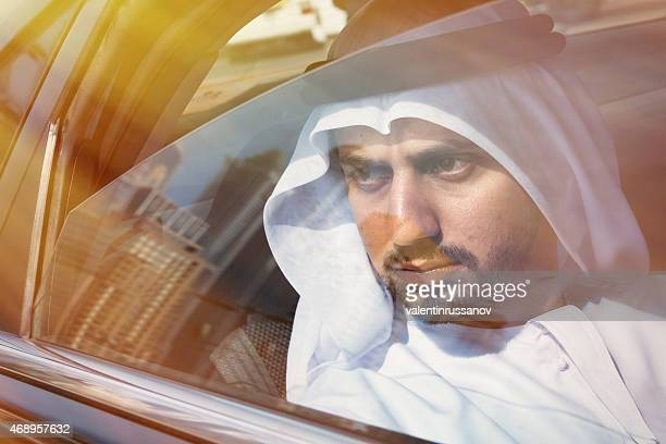 Arab bisunessmen with traditional clothes in a car