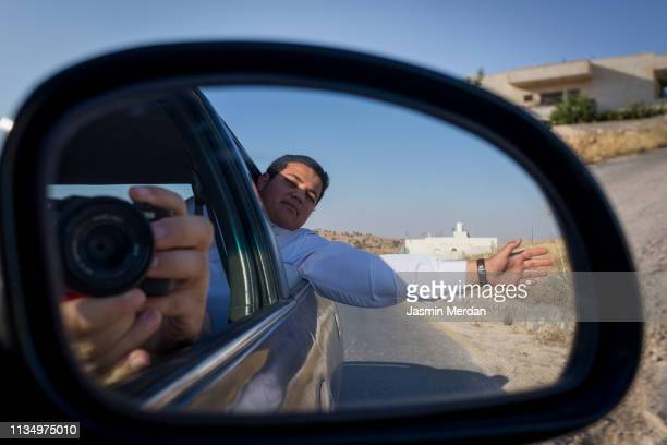 arab boy waving trough car window on trip - jordanian workforce stock pictures, royalty-free photos & images