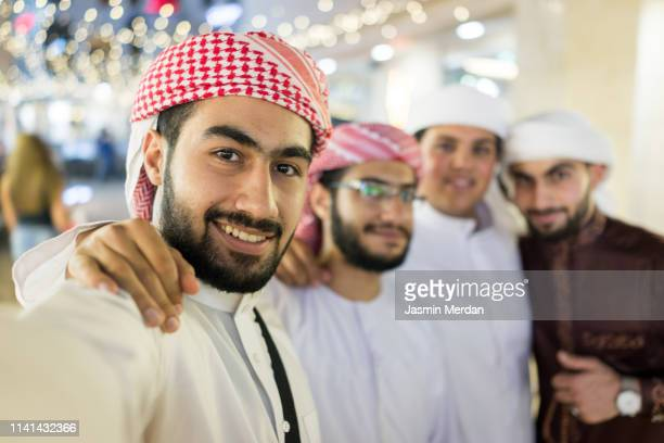 arab boys taking self portrait - ramadan stock pictures, royalty-free photos & images