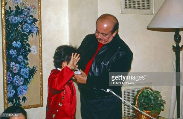 Arab business man Adnan Kashoggi with son Ali while a phone call at New York, USA 1986.