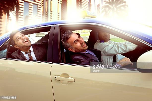 Arab business men in Taxi