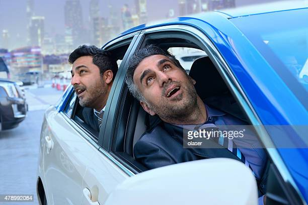 Arab business men in Taxi