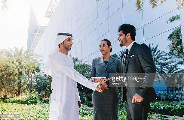 arab business people shaking hands - gulf countries stock pictures, royalty-free photos & images