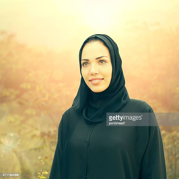 Arab business woman in front defocused sunset background