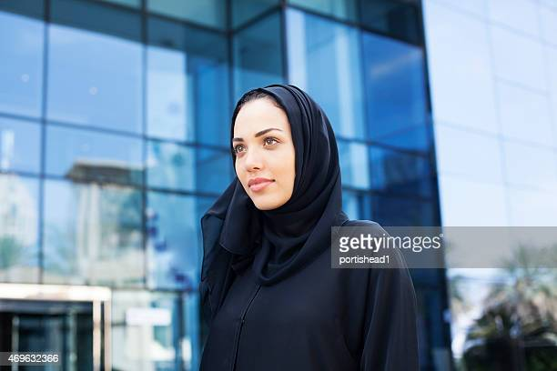Arab business woman in front of modern business building