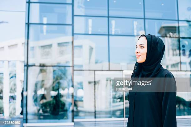 arab business woman in front of modern business building - religious veil stock pictures, royalty-free photos & images