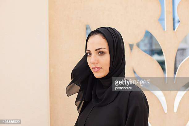 Arab business woman in front of traditional architectural detail