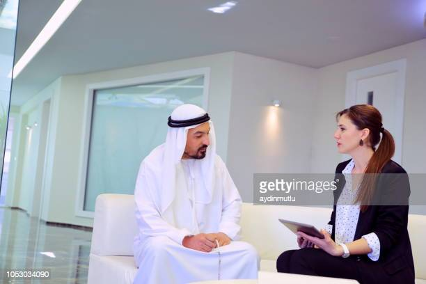 Arab businessman and cooperation woman