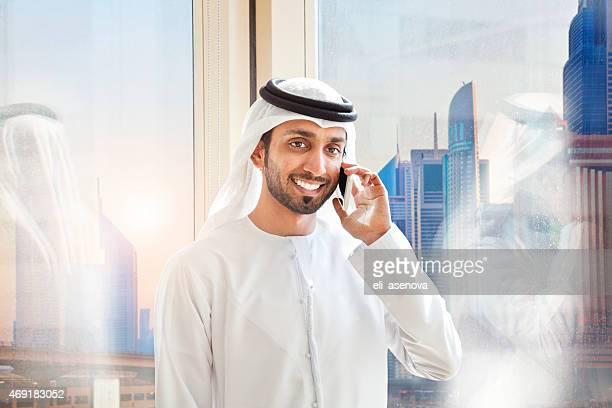 Arab businessman answering mobile phone.