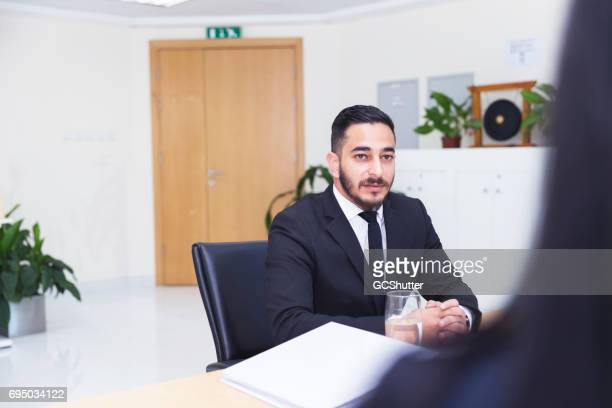 Arab businessman giving a job interview to a female executive