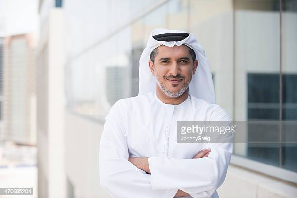 Arab businessman portrait outside office building