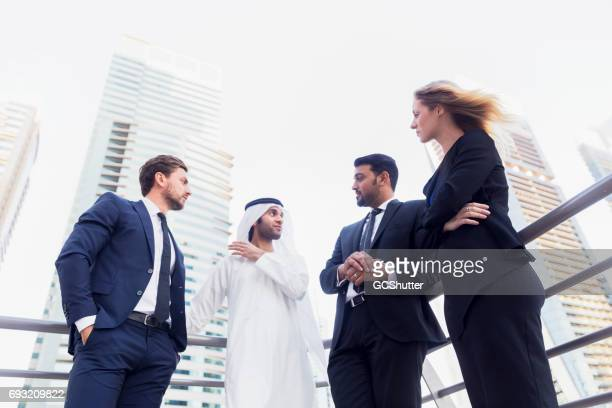 Arab businessman proposing a business deal to foreign investors