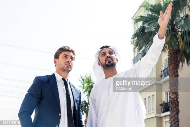 Arab Businessman Showing his Project