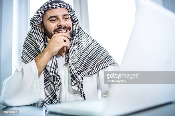 Arab businessman smiling