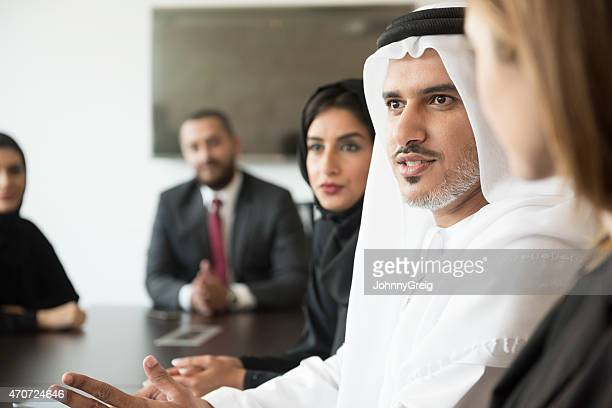 arab businessman talking in a meeting - united arab emirates stock pictures, royalty-free photos & images