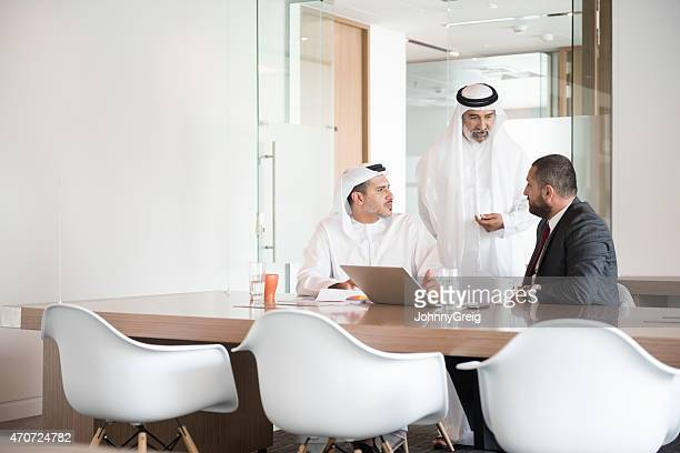 Arab businessmen discussing at conference table