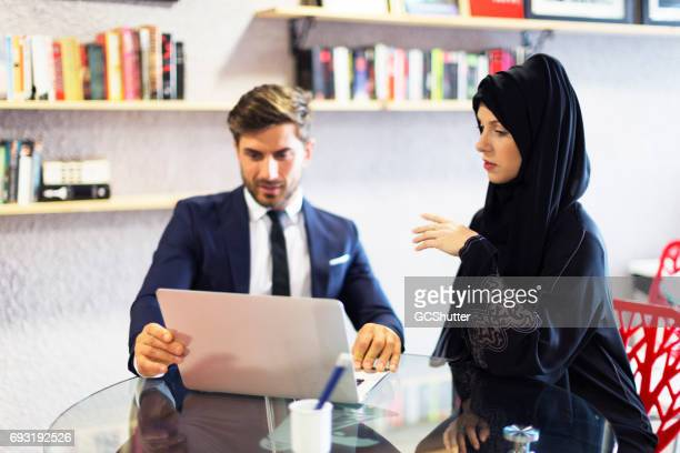 Arab businesswoman explaining a business proposal to a colleague