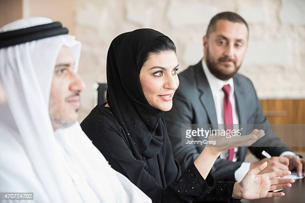 arab businesswoman in business meeting with colleagues - middle east stock pictures, royalty-free photos & images