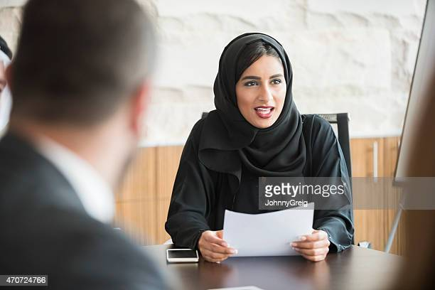 Arab businesswoman wearing traditional abaya in business meeting