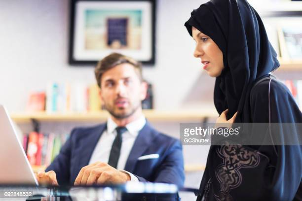 Arab businesswoman working with her colleague