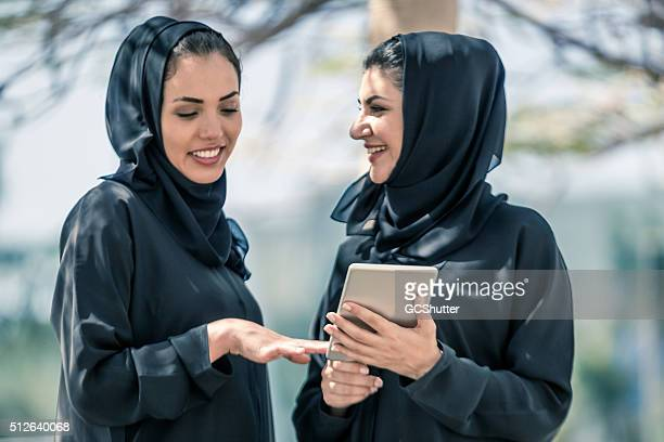 Arab Businesswomen having conversation with Digital Tablet