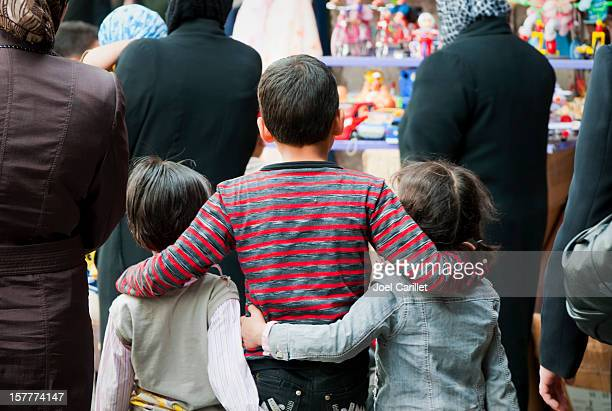 arab children lovingly connected arm-in-arm in damascus, syria - syria stock pictures, royalty-free photos & images