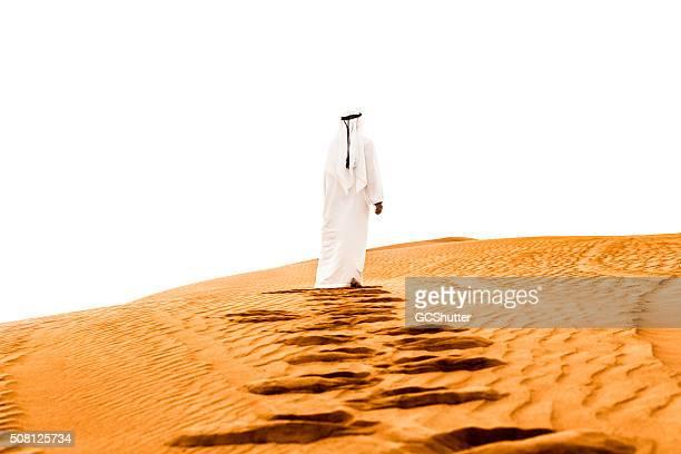 Arab climbing the dunes barefoot