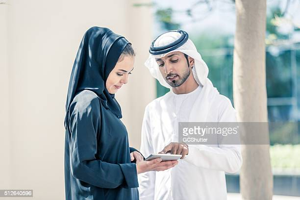 Arab Couple in a Park with Digital Tablet