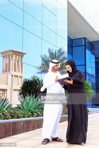Arab couple in front of office building
