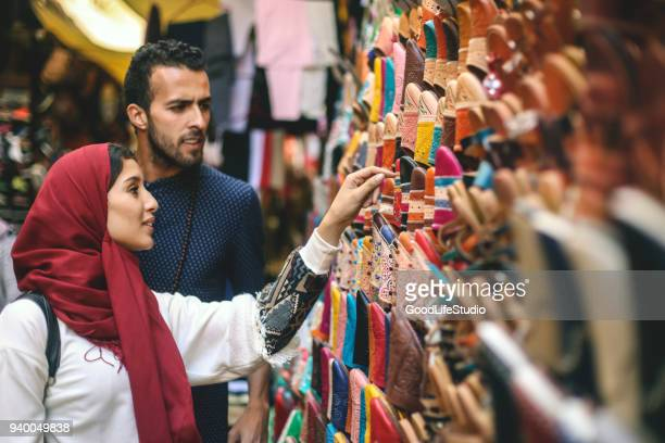 Arab couple looking at slippers