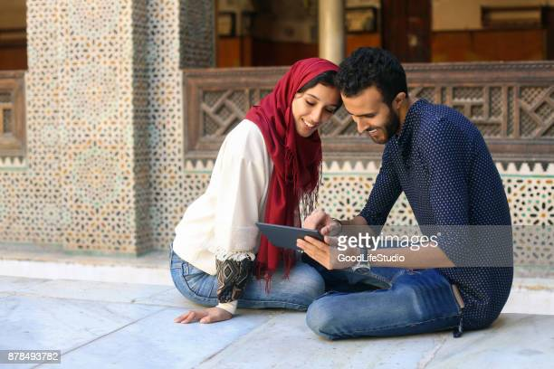Arab couple looking at tablet