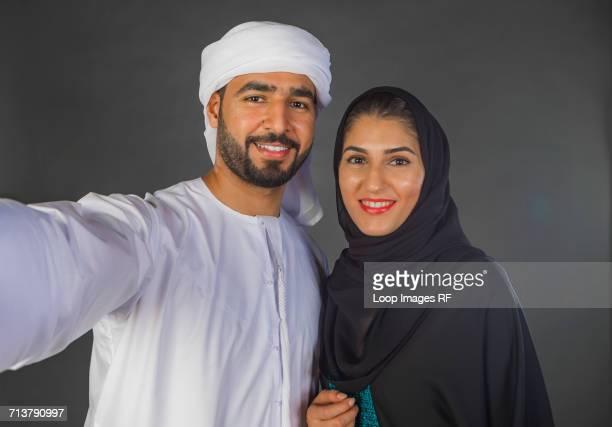 Arab Couple Taking a Selfie|-