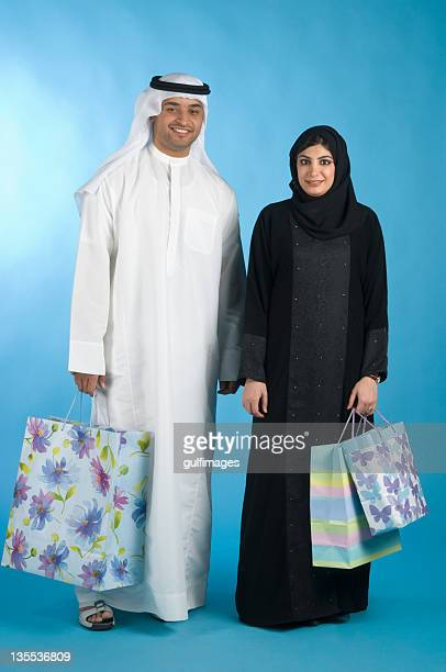 Arab couple with shopping bags