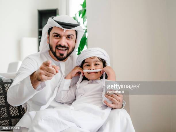 Arab dad and son portrait at home