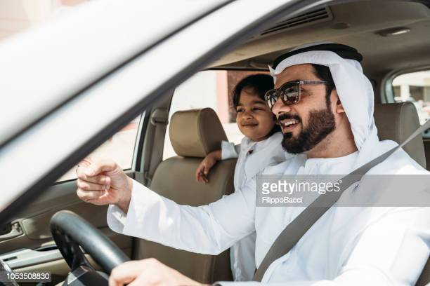 Arab dad in the car with his son
