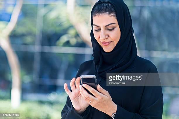 Arab Emirati woman sending a text messgaeportrait