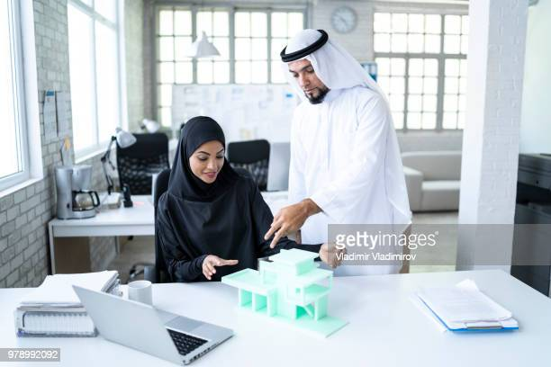 Arab entrepreneur looking at 3D model in office