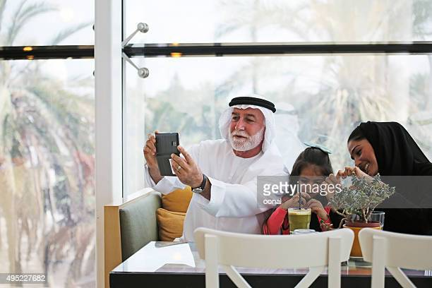 Arab family being taken selfie photograph
