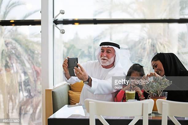 Arab family being taken selfie photograph