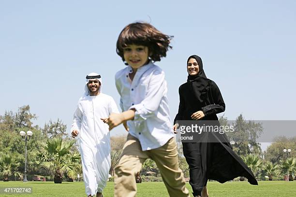 arab family enjoying their leisure time in park - saudi stock pictures, royalty-free photos & images