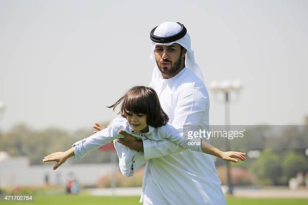 arab family enjoying their leisure time in park - leisure activity stock pictures, royalty-free photos & images