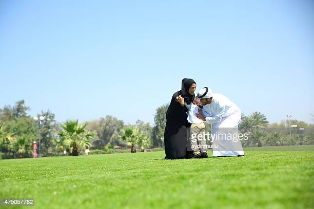 Arab family enjoying their leisure time in park