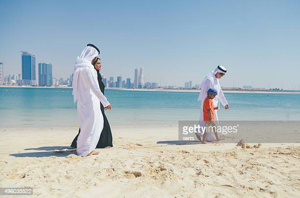 Arab family enjoying their leisure time on beach