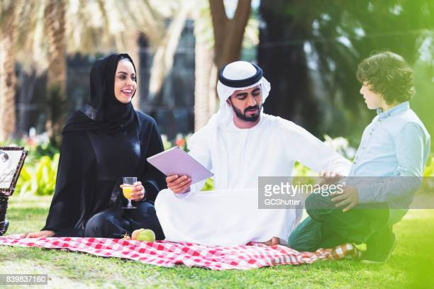 Arab family enjoying their weekend at a park