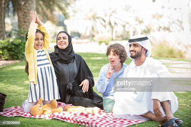 Arab family enjoying time together on picnic outdoors