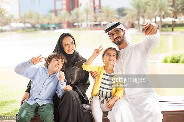 arab family in the park - eid mubarak stock pictures, royalty-free photos & images
