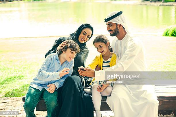 arab family in the park - eid ul fitr stock pictures, royalty-free photos & images