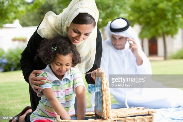Arab family sitting in park.