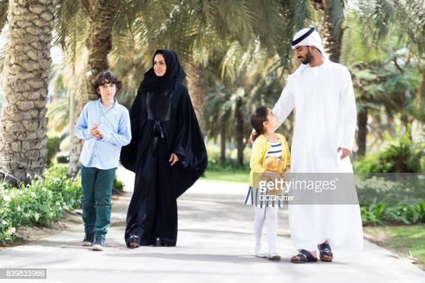 Arab family taking a stroll in a public park